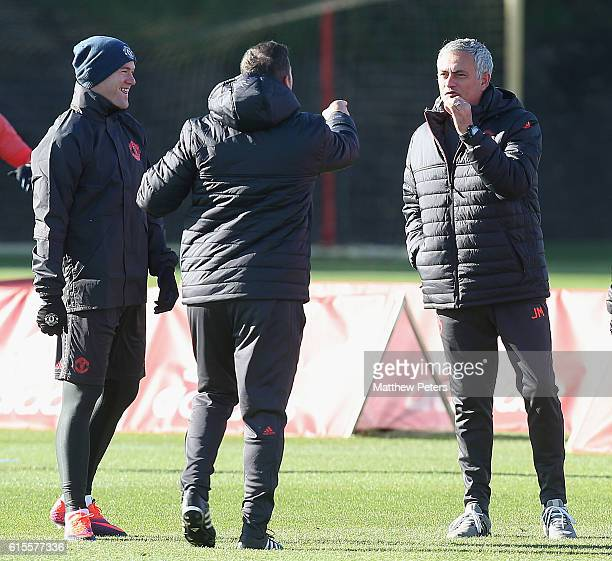 Wayne Rooney and Manager Jose Mourinho of Manchester United in action during a first team training session at Aon Training Complex on October 19 2016...
