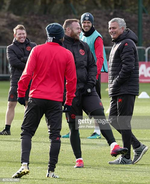 Wayne Rooney and Manager Jose Mourinho of Manchester United in action during a first team training session at Aon Training Complex on November 23...