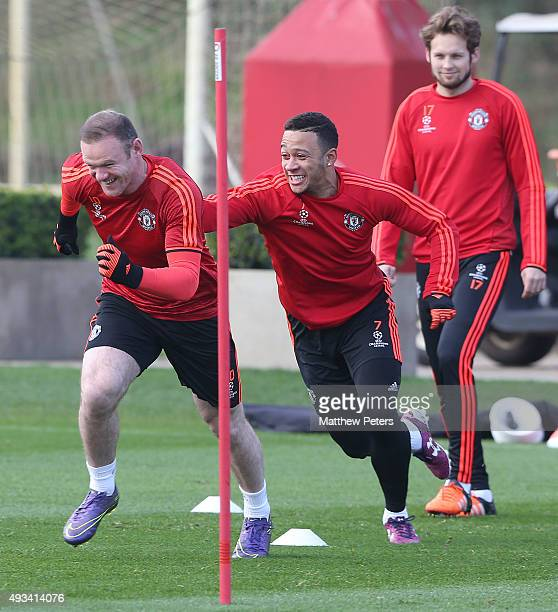 Wayne Rooney and Memphis Depay of Manchester United in action during a first team training session ahead of their UEFA Champions League Group B match...