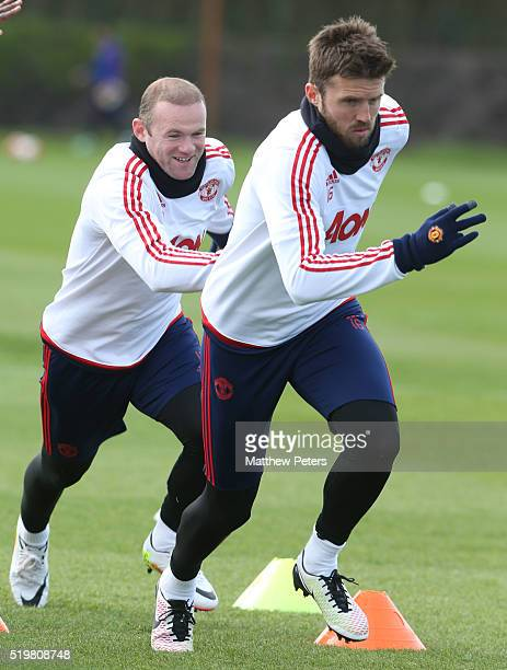Wayne Rooney and Michael Carrick of Manchester United in action during a first team training session at Aon Training Complex on April 8 2016 in...