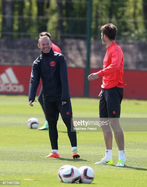 Wayne Rooney and Michael Carrick of Manchester United in action during a first team training session at Aon Training Complex on May 3 2017 in...