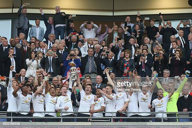 Wayne Rooney and Michael Carrick of Manchester United lift the FA Cup after The Emirates FA Cup final match between Manchester United and Crystal...