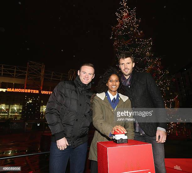 Wayne Rooney and Michael Carrick of Manchester United with Winta Abreha a child from a local school in association with the Manchester United...