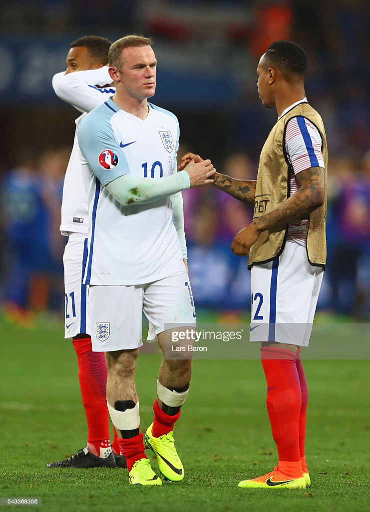 <a gi-track='captionPersonalityLinkClicked' href=/galleries/search?phrase=Wayne+Rooney&family=editorial&specificpeople=157598 ng-click='$event.stopPropagation()'>Wayne Rooney</a> and <a gi-track='captionPersonalityLinkClicked' href=/galleries/search?phrase=Nathaniel+Clyne+-+Soccer+Player&family=editorial&specificpeople=5738873 ng-click='$event.stopPropagation()'>Nathaniel Clyne</a> of England show their dejection after the UEFA EURO 2016 round of 16 match between England and Iceland at Allianz Riviera Stadium on June 27, 2016 in Nice, France.