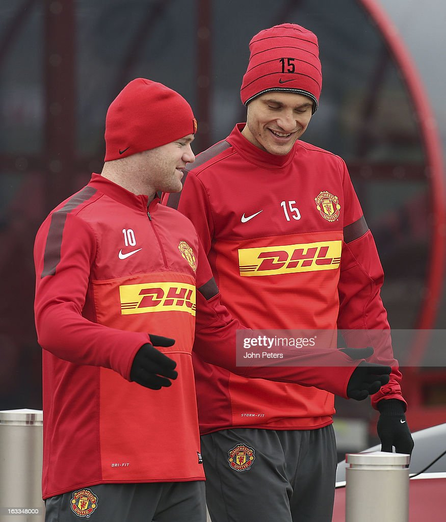 <a gi-track='captionPersonalityLinkClicked' href=/galleries/search?phrase=Wayne+Rooney&family=editorial&specificpeople=157598 ng-click='$event.stopPropagation()'>Wayne Rooney</a> (L) and <a gi-track='captionPersonalityLinkClicked' href=/galleries/search?phrase=Nemanja+Vidic&family=editorial&specificpeople=497253 ng-click='$event.stopPropagation()'>Nemanja Vidic</a> of Manchester United in action during a first team training session at Carrington Training Ground on March 8, 2013 in Manchester, England.