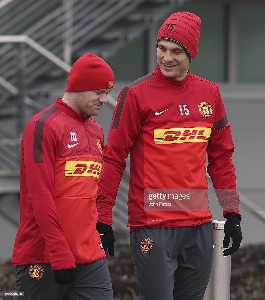 Wayne Rooney (L) and Nemanja Vidic of Manchester United in action during a first team training session at Carrington Training Ground on March 8, 2013 in Manchester, England.
