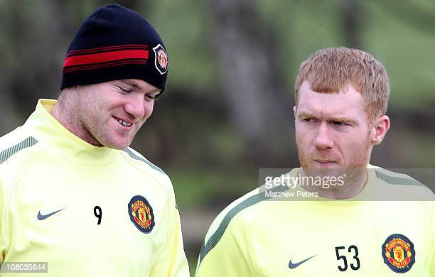 Wayne Rooney and Paul Scholes of Manchester United in action during a first team training session at Carrington Training Ground on January 14 2011 in...