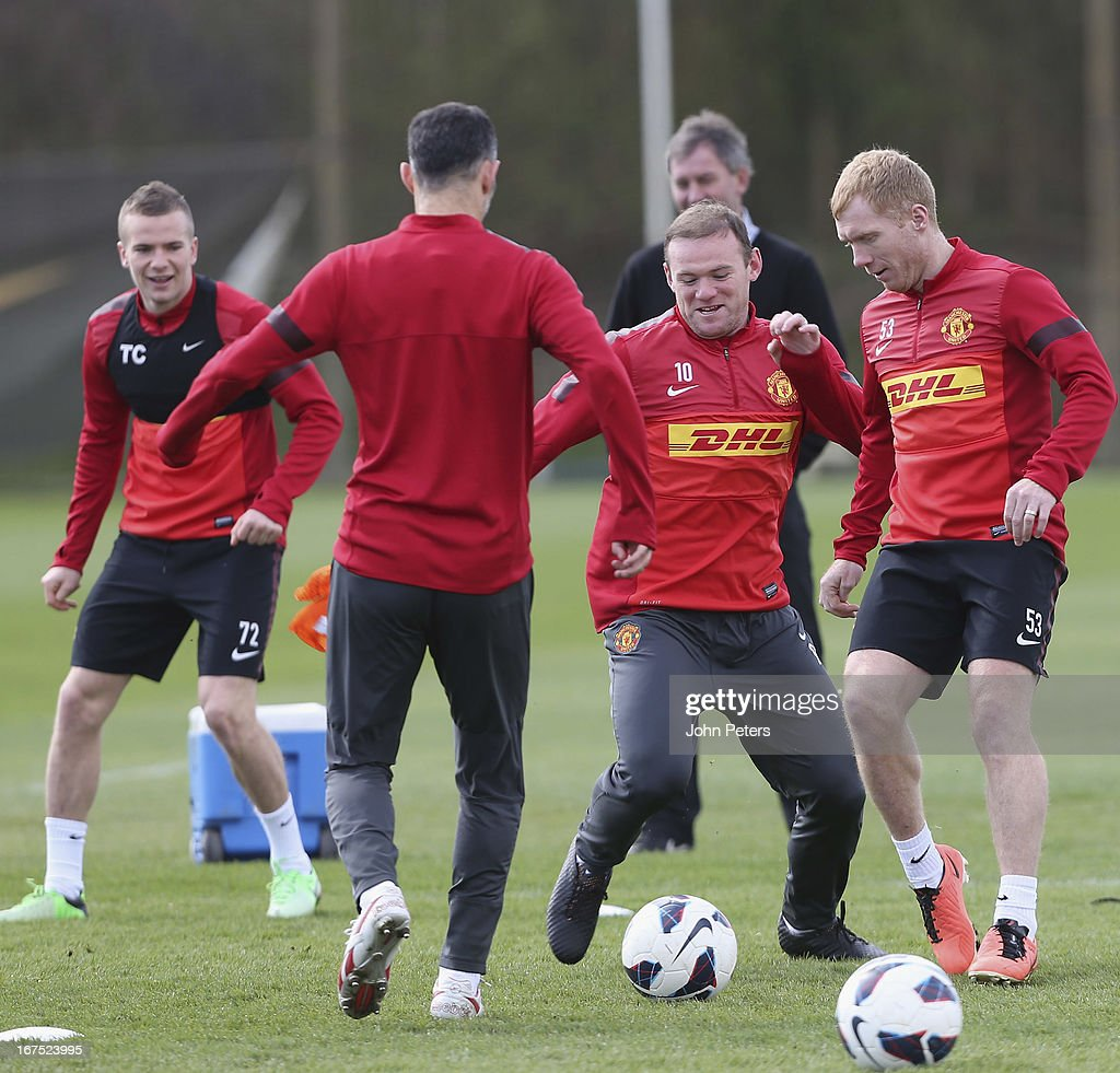 Wayne Rooney and Paul Scholes of Manchester United in actoin during a first team training session at Carrington Training Ground on April 26, 2013 in Manchester, England.