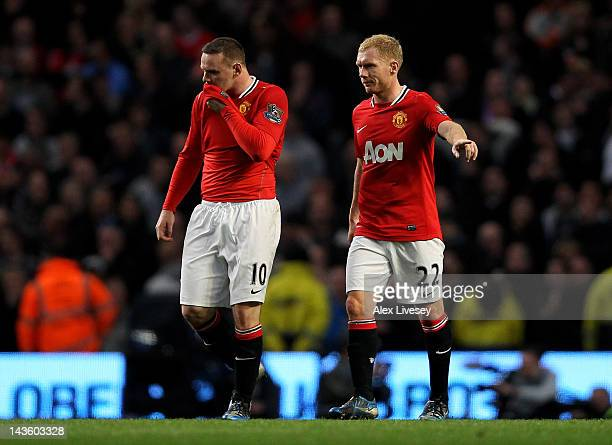 Wayne Rooney and Paul Scholes of Manchester United react after conceding the opening goal during the Barclays Premier League match between Manchester...