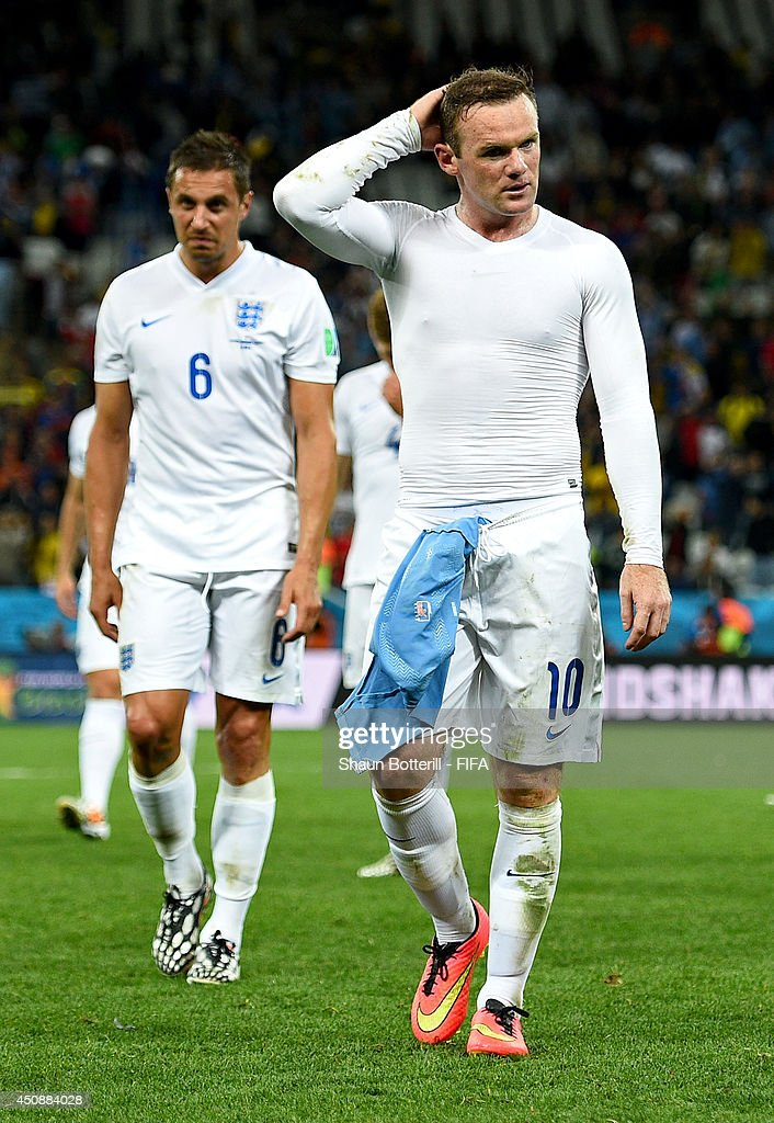 <a gi-track='captionPersonalityLinkClicked' href=/galleries/search?phrase=Wayne+Rooney&family=editorial&specificpeople=157598 ng-click='$event.stopPropagation()'>Wayne Rooney</a> (R) and <a gi-track='captionPersonalityLinkClicked' href=/galleries/search?phrase=Phil+Jagielka&family=editorial&specificpeople=682518 ng-click='$event.stopPropagation()'>Phil Jagielka</a> of England walk off the pitch after the 2014 FIFA World Cup Brazil Group D match between Uruguay and England at Arena de Sao Paulo on June 19, 2014 in Sao Paulo, Brazil.