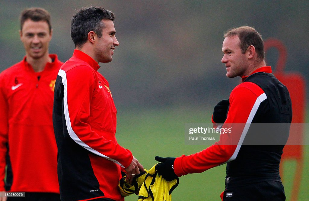 Wayne Rooney (R) and Robin van Persie of Manchester United talk during a training session ahead of their Champions League Group A match against Shakhtar Donetsk at their Carrington Training Complex on October 01, 2013 in Manchester, England
