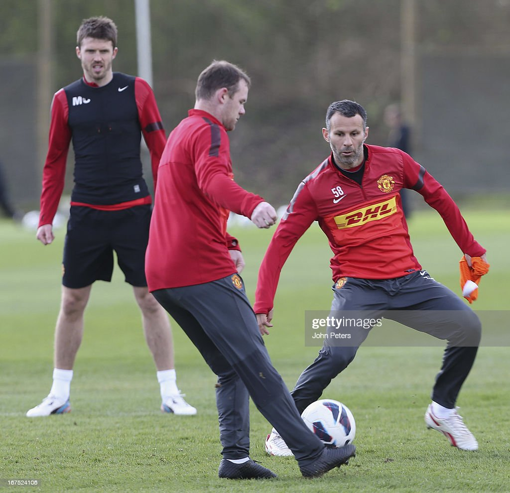 Wayne Rooney and Ryan Giggs of Manchester United in actoin during a first team training session at Carrington Training Ground on April 26, 2013 in Manchester, England.