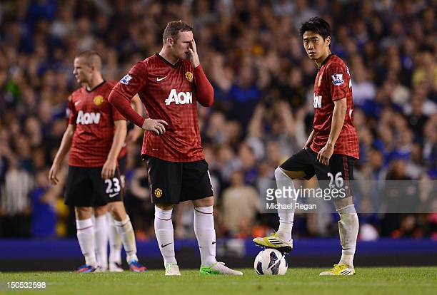 Wayne Rooney and Shinji Kagawa of Manchester United look dejected after conceding the opening goal during the Barclays Premier League match between...