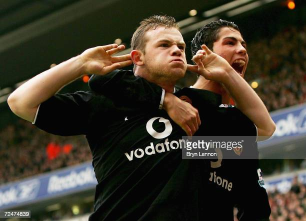Wayne Rooney and team mate Cristiano Ronaldo of Manchester United celebrate Rooney's goal during the Barclays Premiership match between Liverpool and...