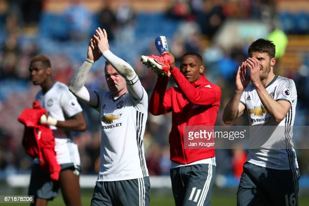 Wayne Rooney Anthony Martial and Michael Carrick of Manchester United applaud the fans after the Premier League match between Burnley and Manchester...