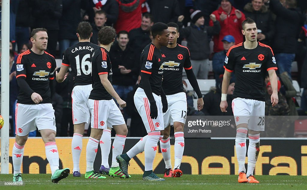 <a gi-track='captionPersonalityLinkClicked' href=/galleries/search?phrase=Wayne+Rooney&family=editorial&specificpeople=157598 ng-click='$event.stopPropagation()'>Wayne Rooney</a>, Anthony Martial and Morgan Schneiderlin of Manchester United react to Wahbi Khazri of Sunderland scoring their first goal during the Barclays Premier League match between Sunderland and Manchester United at Stadium of Light on February 13, 2016 in Sunderland, England.