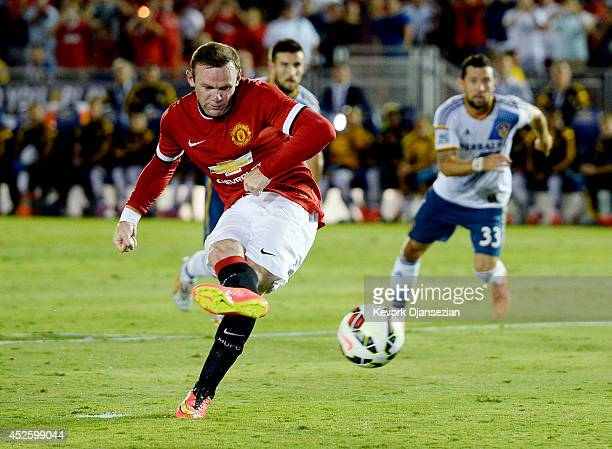 Wayne Rooney aof Manchester United scores a goal on a penalty kick against Los Angeles Galaxy during the preseason friendly match between Los Angeles...