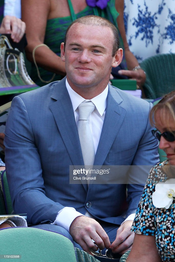 Wayne Rooney attends the Gentlemen's Singles Final match between Andy Murray of Great Britain and Novak Djokovic of Serbia on day thirteen of the Wimbledon Lawn Tennis Championships at the All England Lawn Tennis and Croquet Club on July 7, 2013 in London, England.