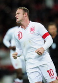 Wayne Rooney captain of England celebrates after scoring the opening goal from the penalty spot during the FIFA 2014 World Cup Group H qualifying...