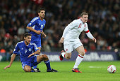 Wayne Rooney captain of England competes for the ball with Michele Cervellini of San Marino during the FIFA 2014 World Cup Group H qualifying match...