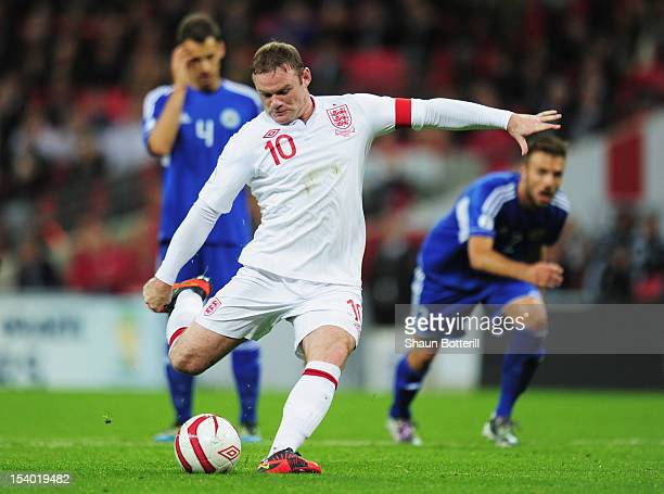 Wayne Rooney captain of England scores the opening goal from the penalty spot during the FIFA 2014 World Cup Group H qualifying match between England...