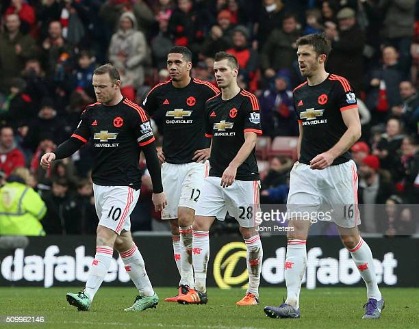 Wayne Rooney Chris Smalling Morgan Schneiderlin and Michael Carrick of Manchester United react to Lamine Kone of Sunderland scoring their second goal...