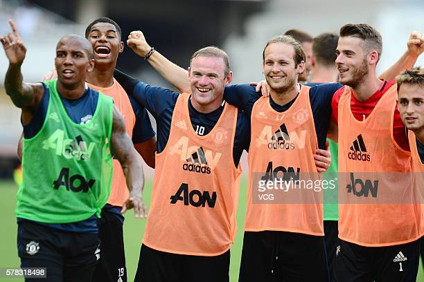 Wayne Rooney Daley Blind and David de Gea of Manchester United attends first team training session as part of their preseason tour of China during...
