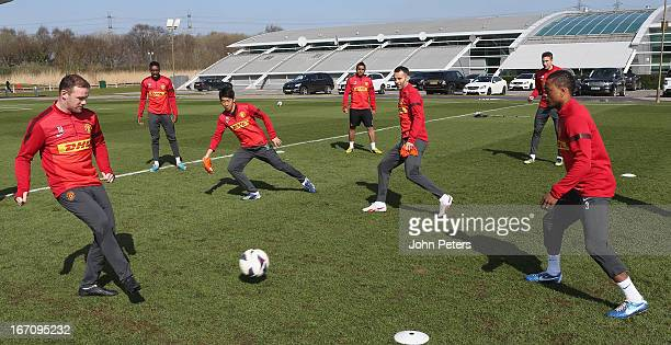 Wayne Rooney Danny Welbeck Shinji Kagawa Anderson Ryan Giggs Robin van Persie and Patrice Evra of Manchester United in action during a first team...