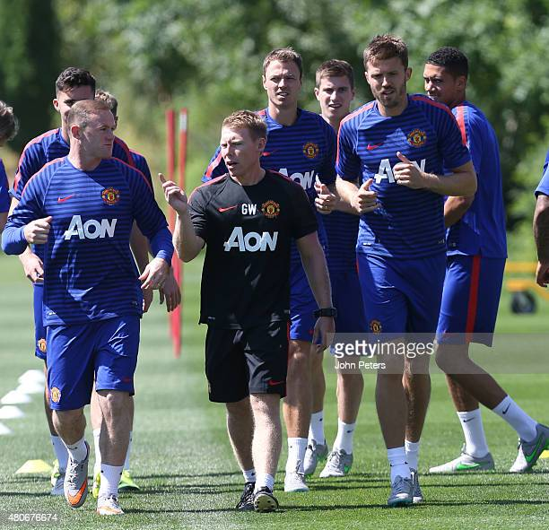 Wayne Rooney Fitness coach Gary Walker and Michael Carrick of Manchester United in action during a first team training session as part of their...