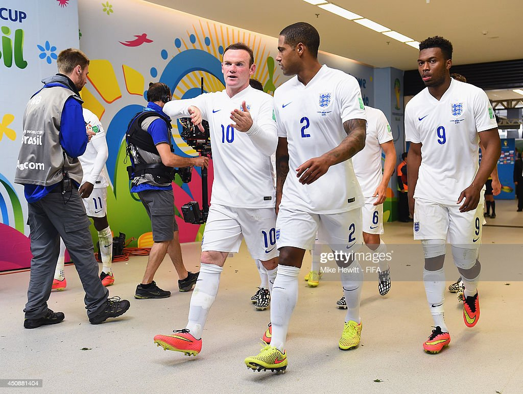 Wayne Rooney, Glen Johnson and Daniel Sturridge of England walk in the tunnel to the dressing room during the 2014 FIFA World Cup Brazil Group D match between Uruguay and England at Arena de Sao Paulo on June 19, 2014 in Sao Paulo, Brazil.