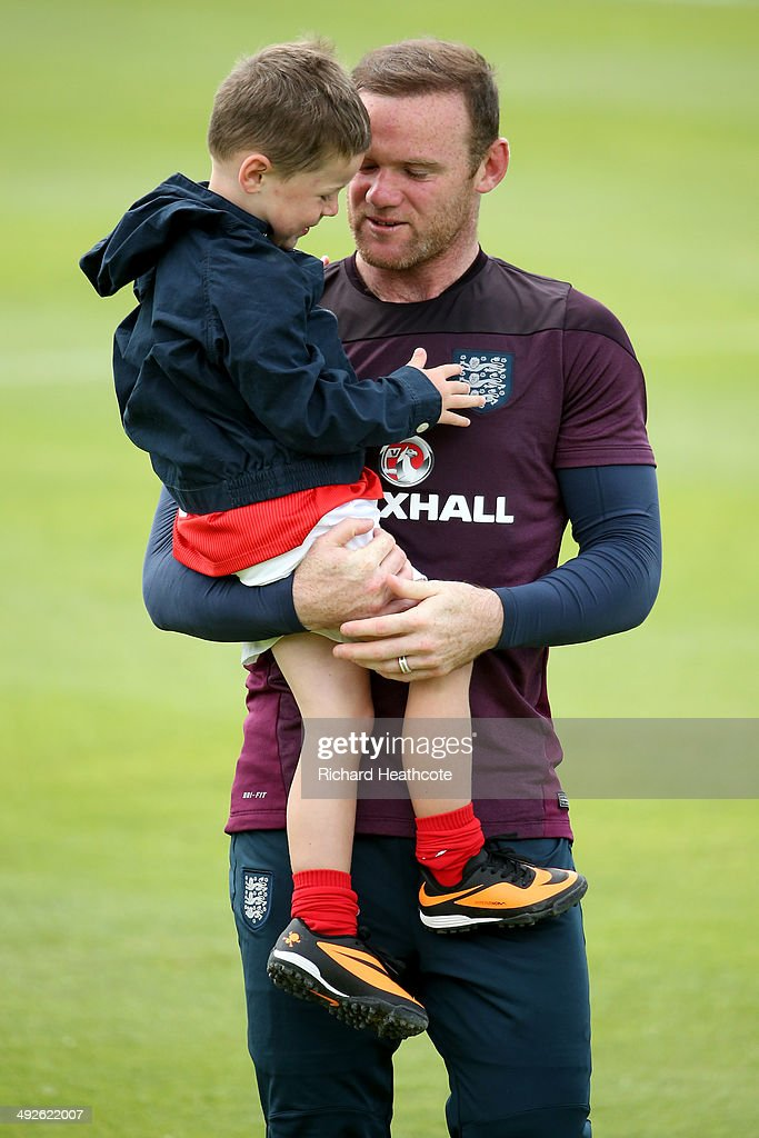 Wayne Rooney hugs his son Kai at the end of a training session at the England pre-World Cup Training Camp at the Vale Do Lobo Resort on May 21, 2014 in Vale Do Lobo, Algarve, Portugal.