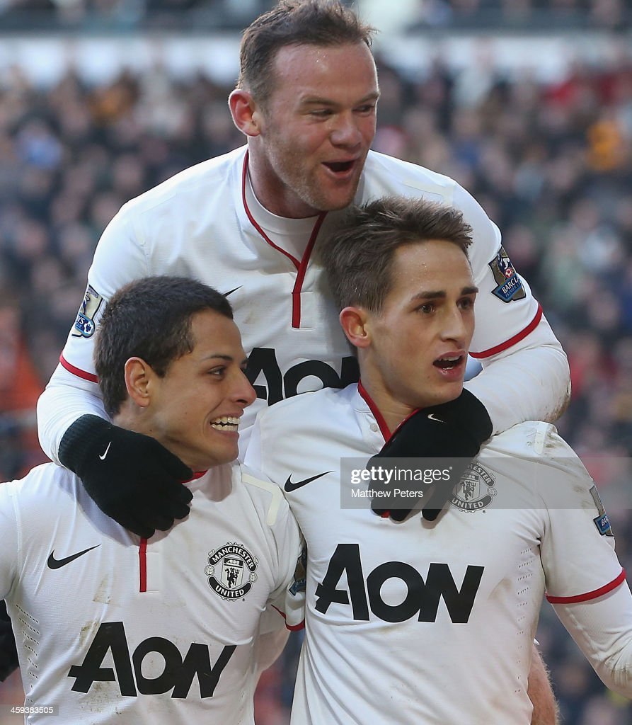 <a gi-track='captionPersonalityLinkClicked' href=/galleries/search?phrase=Wayne+Rooney&family=editorial&specificpeople=157598 ng-click='$event.stopPropagation()'>Wayne Rooney</a>; Javier 'Chicharito' Hernandez and <a gi-track='captionPersonalityLinkClicked' href=/galleries/search?phrase=Adnan+Januzaj&family=editorial&specificpeople=8291259 ng-click='$event.stopPropagation()'>Adnan Januzaj</a> of Manchester United celebrate James Chester of Hull City scoring an own goal during the Barclays Premier League match between Hull City and Manchester United at KC Stadium on December 26, 2013 in Hull, England.