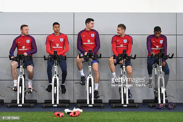 Wayne Rooney Jesse Lingard Michael Keane Jamie Vardy and Marcus Rashford warm up on bikes during the England training session on October 5 2016 in...