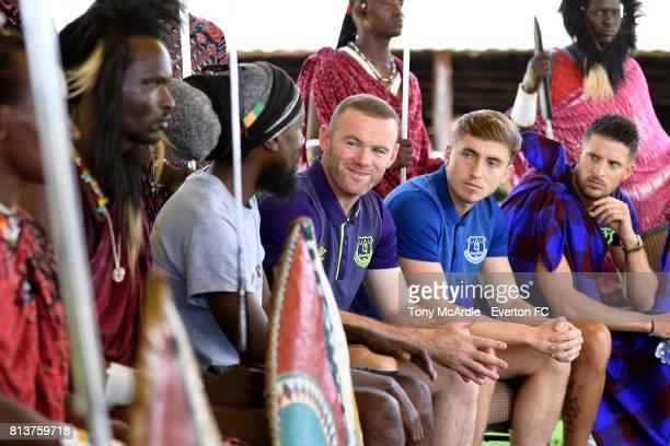 Wayne Rooney Jonjoe Kenny and Kevin Mirallas of Everton meet Maasai Warriors in DarEsSalaam on July 12 2017 in Tanzania