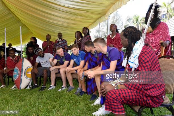 Wayne Rooney Jonjoe Kenny Kevin Mirallas and Morgan Schneiderlin of Everton meet Maasai Warriors in DarEsSalaam on July 12 2017 in Tanzania