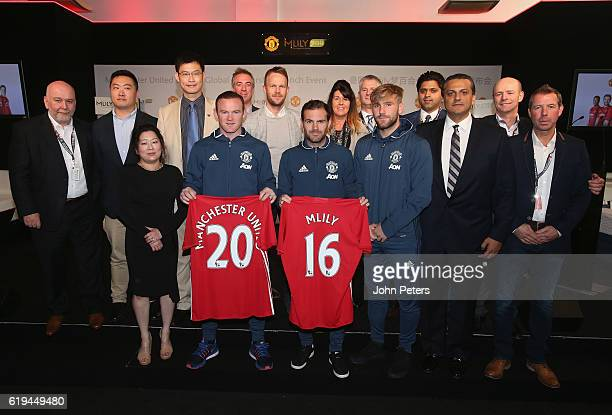 Wayne Rooney Juan Mata and Luke Shaw and of Manchester United pose with CEO James Ni of Mlily and guests at the launch of the club's partnership with...