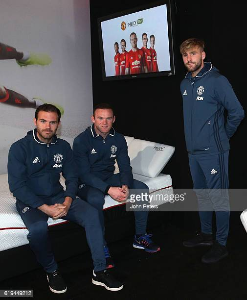 Wayne Rooney Juan Mata and Luke Shaw of Manchester United pose at the launch of the club's partnership with Mlily at Aon Training Complex on October...