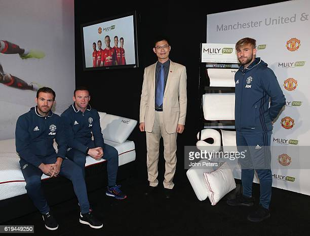 Wayne Rooney Juan Mata and Luke Shaw of Manchester United pose with CEO James Ni of Mlily at the launch of the club's partnership with Mlily at Aon...