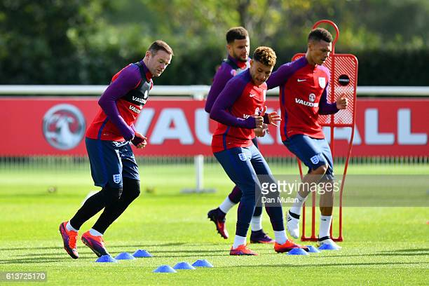 Wayne Rooney Kyle Walker Alex OxladeChamberlain and Kieran Gibbs run during an England training session at the Tottenham Hotspur training ground on...