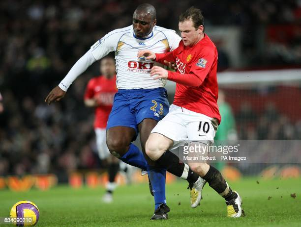 Wayne Rooney Manchester United and Sol Campbell Portsmouth battle for the ball