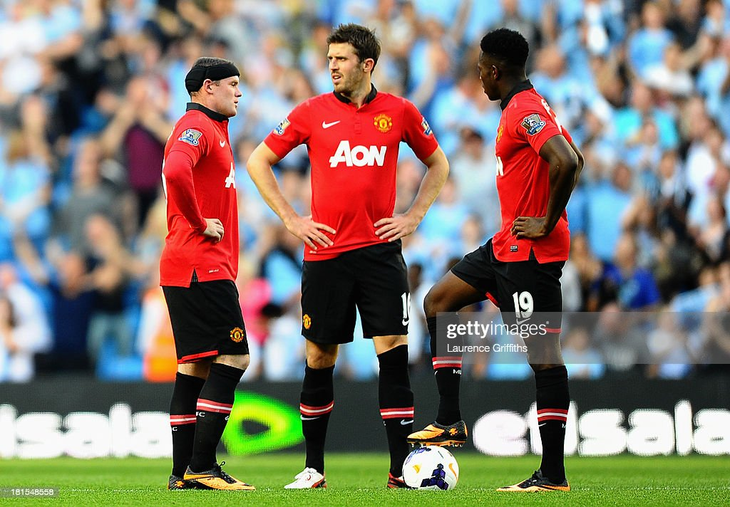 Wayne Rooney, Michael Carrick and Danny Welbeck of Manchester United look dejected during the Barclays Premier League match between Manchester City and Manchester United at the Etihad Stadium on September 22, 2013 in Manchester, England.