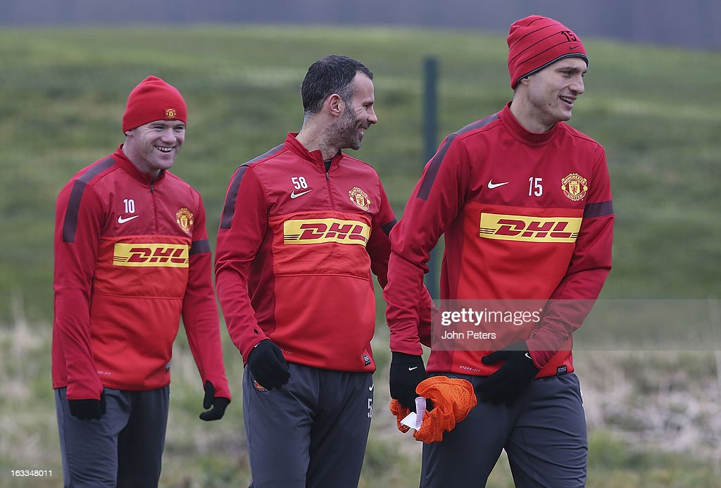 Wayne Rooney, Nemanja Vidic and Ryan Giggs of Manchester United in action during a first team training session at Carrington Training Ground on March 8, 2013 in Manchester, England.