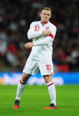 Wayne Rooney of England adjusts his captain's armband during the FIFA 2014 World Cup Group H qualifying match between England and San Marino at...