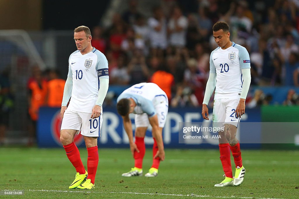 <a gi-track='captionPersonalityLinkClicked' href=/galleries/search?phrase=Wayne+Rooney&family=editorial&specificpeople=157598 ng-click='$event.stopPropagation()'>Wayne Rooney</a> of England and <a gi-track='captionPersonalityLinkClicked' href=/galleries/search?phrase=Dele+Alli&family=editorial&specificpeople=9976958 ng-click='$event.stopPropagation()'>Dele Alli</a> look dejected after conceding a second goal during the UEFA Euro 2016 Round of 16 match between England and Iceland at Allianz Riviera Stadium on June 27, 2016 in Nice, France.