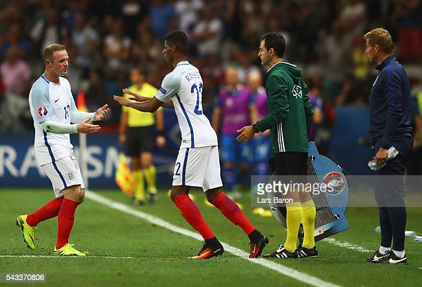 Wayne Rooney of England and Marcus Rashford high five during the UEFA EURO 2016 round of 16 match between England and Iceland at Allianz Riviera...