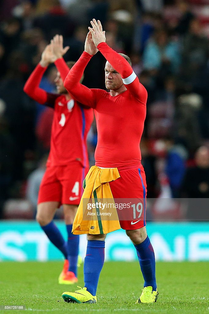 <a gi-track='captionPersonalityLinkClicked' href=/galleries/search?phrase=Wayne+Rooney&family=editorial&specificpeople=157598 ng-click='$event.stopPropagation()'>Wayne Rooney</a> of England applauds fans following the International Friendly match between England and Australia at Stadium of Light on May 27, 2016 in Sunderland, England.