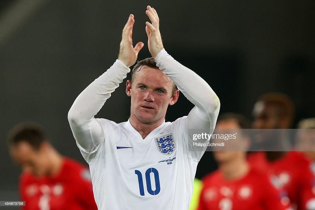 <a gi-track='captionPersonalityLinkClicked' href=/galleries/search?phrase=Wayne+Rooney&family=editorial&specificpeople=157598 ng-click='$event.stopPropagation()'>Wayne Rooney</a> of England applauds the fans after the EURO 2016 Qualifier match between Switzerland and England on September 8, 2014 in Basel, Switzerland.