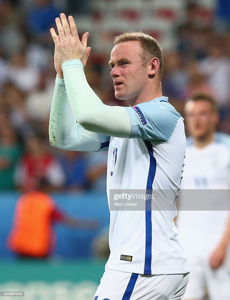 <a gi-track='captionPersonalityLinkClicked' href=/galleries/search?phrase=Wayne+Rooney&family=editorial&specificpeople=157598 ng-click='$event.stopPropagation()'>Wayne Rooney</a> of England applauds the supporters after his team's 1-2 defeat in the UEFA EURO 2016 round of 16 match between England and Iceland at Allianz Riviera Stadium on June 27, 2016 in Nice, France.