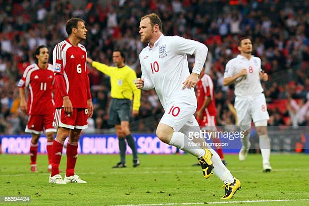 Wayne Rooney of England celebrates after he scores the third goal of the game during the FIFA 2010 World Cup Group 6 Qualifying match between England...