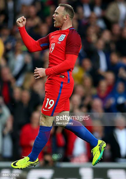 Wayne Rooney of England celebrates after scoring his team's second goal of the game during the International Friendly match between England and...
